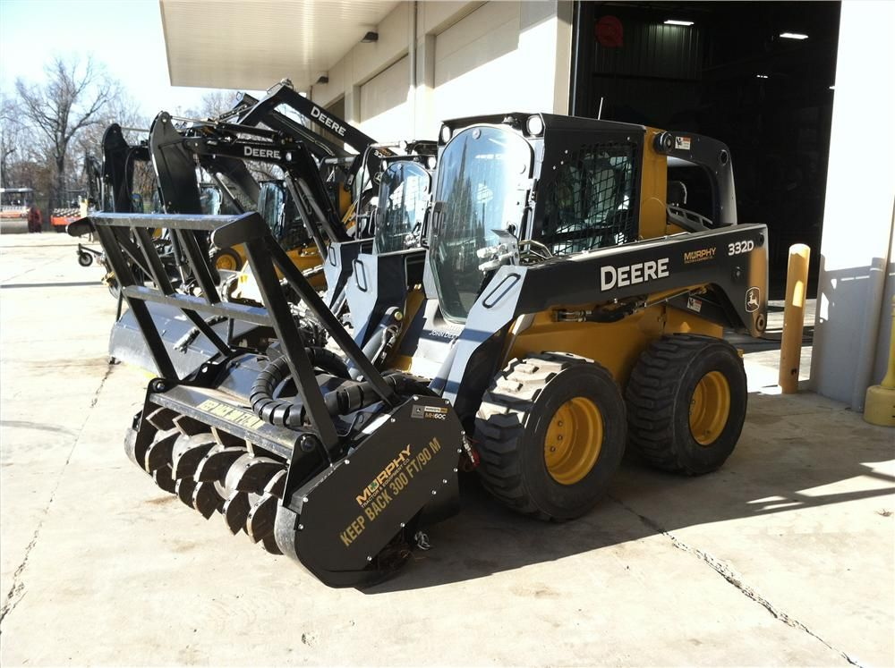 A John Deere 332D skid steer, equipped with a Worksite Pro MH 60C mulching head.