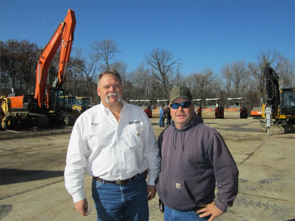 Ben Aldrich (L), customer support advisor, Murphy Tractor & Equipment Co. Inc., and customer Duane Bailey of Bailey Farms enjoy the beautiful weather during Murphy Tractor's customer appreciation event.