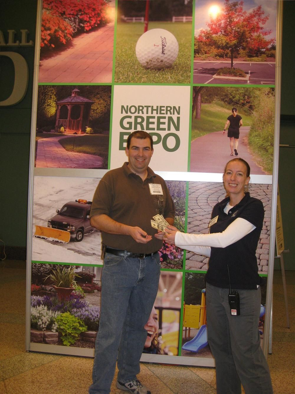 Richard Ohm of Flying W Gardens, Park Rapids, Minn., accepts a grand prize of $250  from Jordi Larson of the Northern Green Expo.