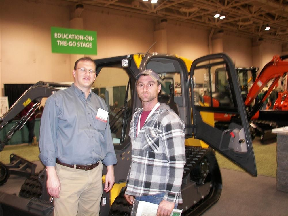 Nuss Truck & Equipment Regional Sales Manager Peter Stroh (L) answers questions about his company's equipment lineup for Andrew Berthiaume, landscape foreman of JT Construction, Elk River, Minn.