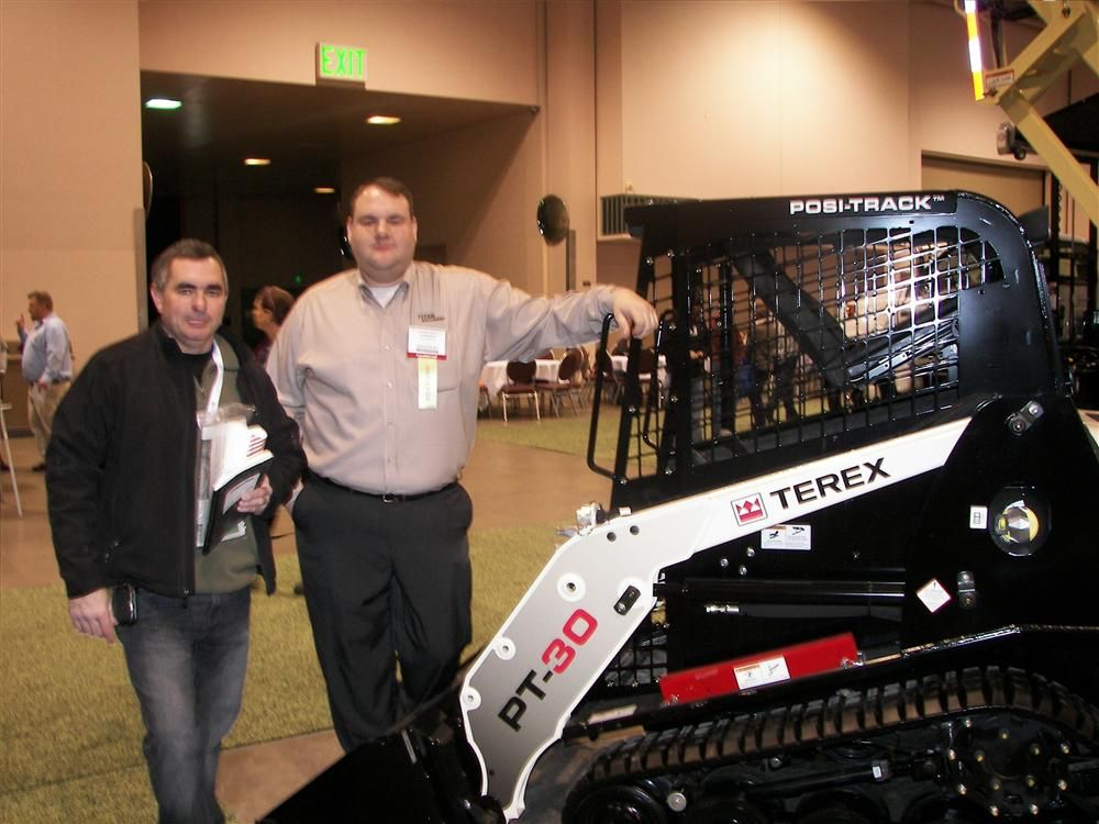 Charles Mathison (L) of Bachman's, Lyndale, Minn., stopped by the Titan Machinery booth to talk with Andy Bethel about new equipment, including the Terex PT-30.