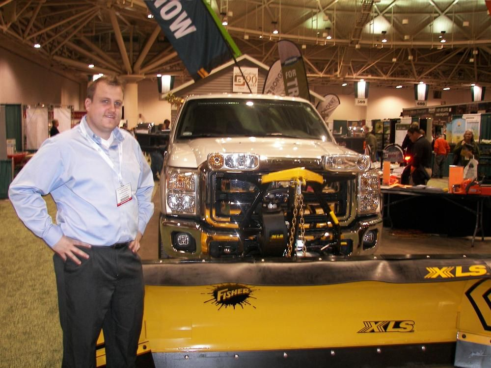 Stonebrooke Equipment, Burnsville, Minn., displayed this expandable Fisher plow. Inside Sales Representative Josh Sowada said his company has everything from plows to lights and toolboxes to winches.