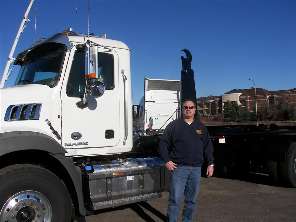 Terry Hoops of Truck Utilities, St. Paul, Minn., was on hand to answer any questions on the 50,000 lb. hook lift system installed on this 2013 Mack Granite Series truck.