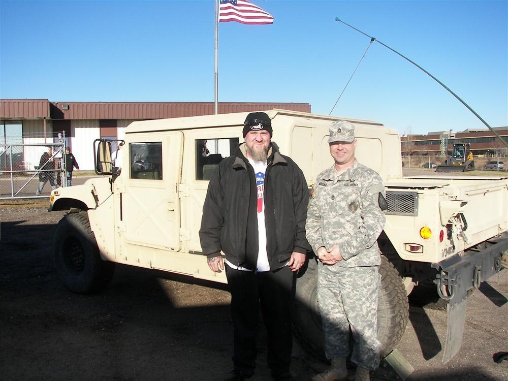 Matt Wolfard (L), repair specialist, Nuss Truck & Equipment, with Army National Guardsman SFC Donald M. Nosko, Recruiting & Retention NCO, Roseville, Minn.