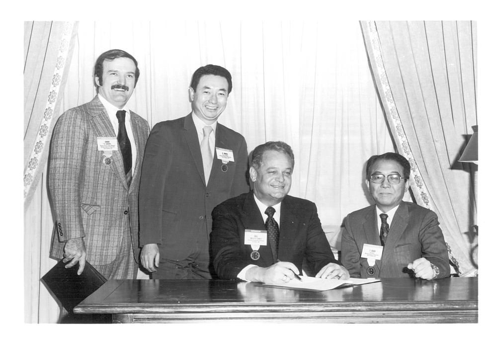 Bill Early signs the Komatsu contract.