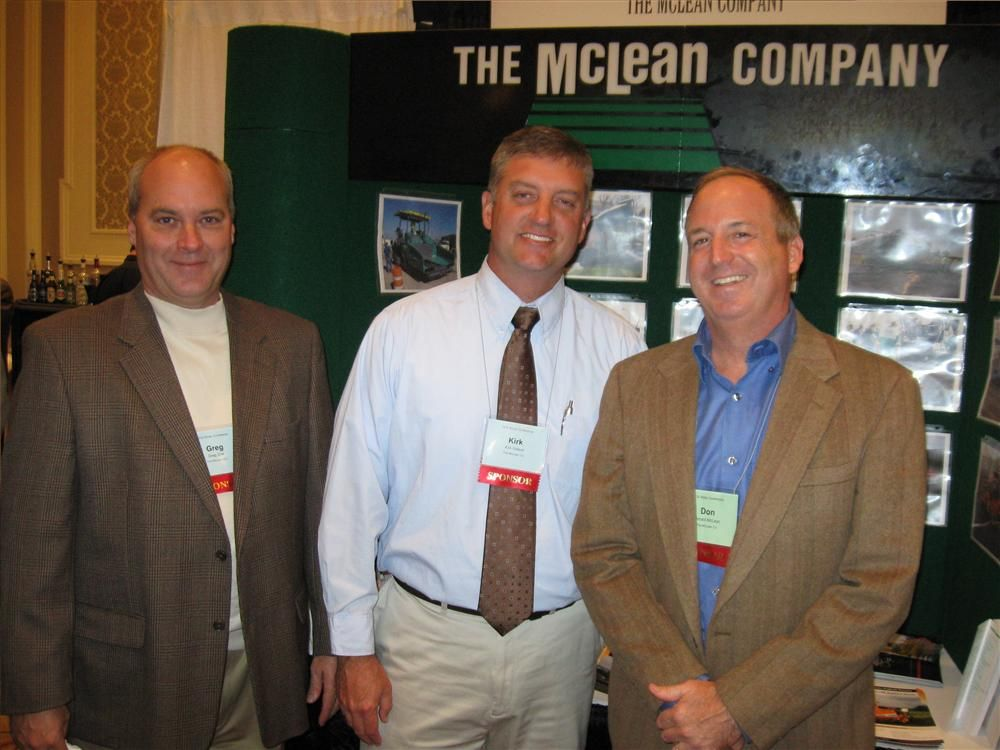 (L-R): The McLean Company's Greg Zink, Kirk Sidwell and Don McLean welcome attendees to their exhibit featuring Hyundai and LeeBoy machines.