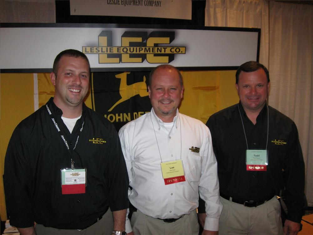 (L-R): Richard Petty, Lee Wigal and Todd Perrine of Leslie Equipment provided information on John Deere equipment to attendees.
