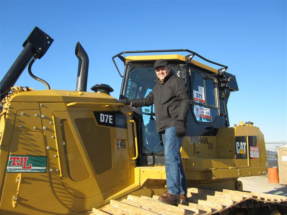Kevin Michels, Michels Corporation, looks over this Cat D7E dozer.