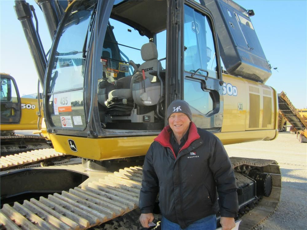 Larry Yoder, Farm Drainage, inspects this John Deere 350D excavator.