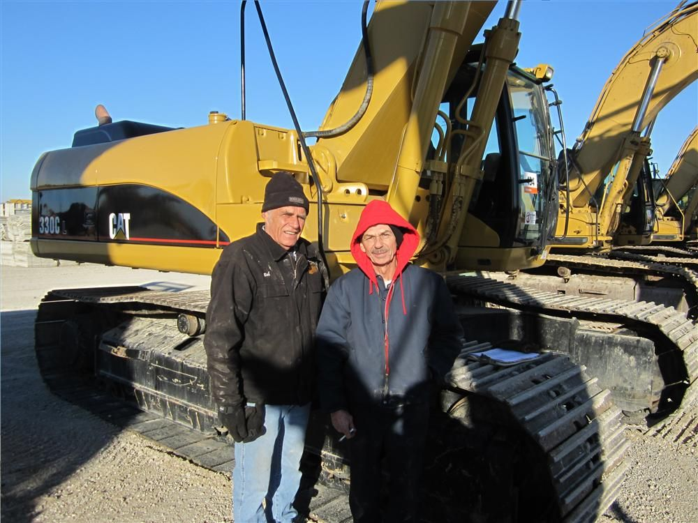 Bob Halderson (L), and Cliff Grice, both of Corporate Contractors Inc., Beloit, Wis., came to see the well maintained cat excavators.