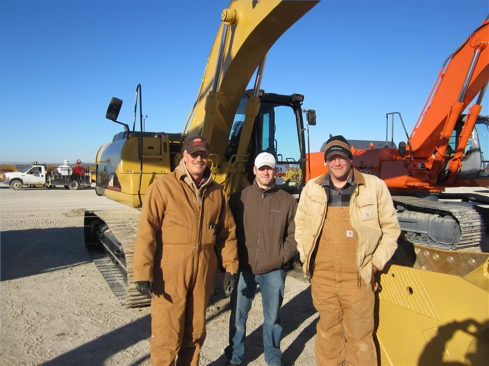 (L-R): Jim Lindsey, Lindsey Farms, brought sons Matt and Luke to see if they could take home an excavator.