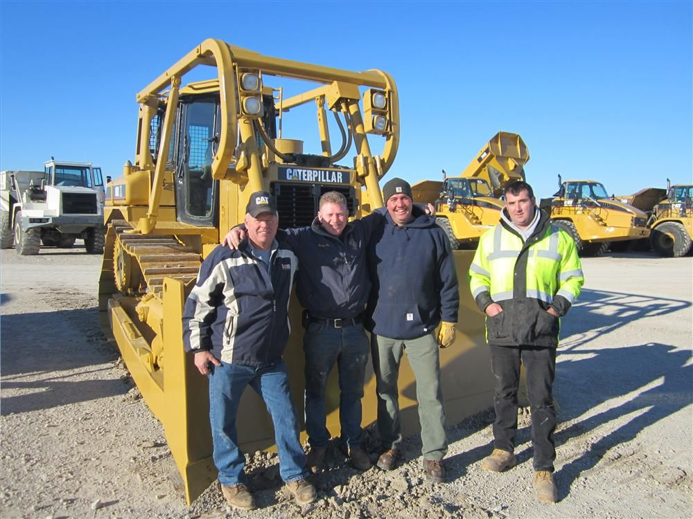 This Cat D6R XL dozer got the attention of this group. (L-R) are Bill Boehm, Primary Contractors; Davey McCallion, Pro Excavating; Dale Hereau and John Hagan, both of Primary Contractors.