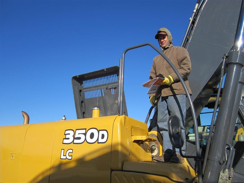 Terry Laible, owner of Terry Laible Excavating, was very interested in bidding on this John Deere 350D excavator.