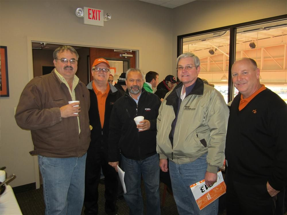 (L-R): Viewing the auction from the the VIP room are John Moyna, C.J. Moyna Inc.; Roger Martinez, Ritchie Bros.; Bob Pietrantonio, Ryan Central; Jerry Thompson, T.J. Lambrecht Construction; and Nick Nicholson, senior vice president of Ritchie Bros.