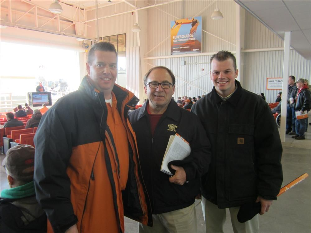 (L-R): Jim Ban, Ritchie Bros.; Dominic Giuffre, vice president of Giuffre Bros. Cranes Inc., and Chris Wilke, also of Giuffre Bros., stop for a quick picture before heading out to the auction yard to look over the boom trucks.