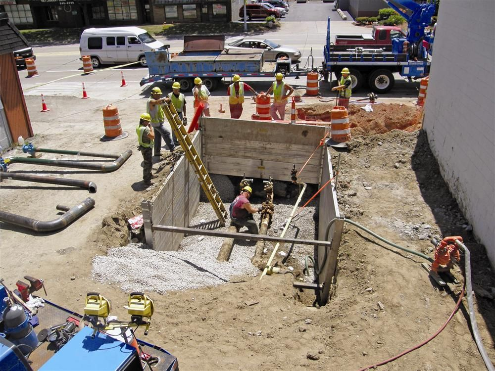 The regulation station is located closely between two buildings and the side walk along 11-Mile, which made excavating and removing the existing concrete vault difficult.