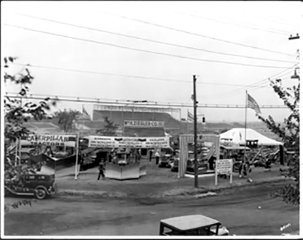 Area Caterpillar dealers displayed a variety of equipment for public inspection at the 1930 Minnesota State Fair. The display showcased Caterpillar combines, a Cat Thirty snow special, graders and Cat Ten, Fifteen, Twenty and Sixty track-type tractors.