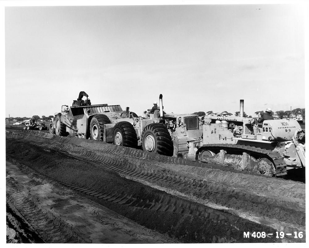 The interstate highway system was designed to be controlled access and to have a minimum of two traffic lanes in each direction with a width of twelve feet each. The right shoulder was mandated to be ten feet wide and paved. The highway itself would be su