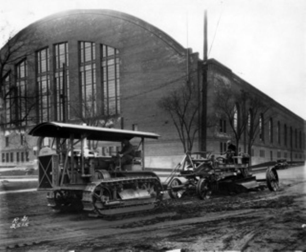 A Caterpillar Sixty pulls a Russell Super Reliance pull grader with scarifier in front of Williams Arena at the  University of Minnesota. In December of 1928, the Caterpillar Tractor Co. purchased the Russell Grader Mfg. Co. This purchase gave dealers lik