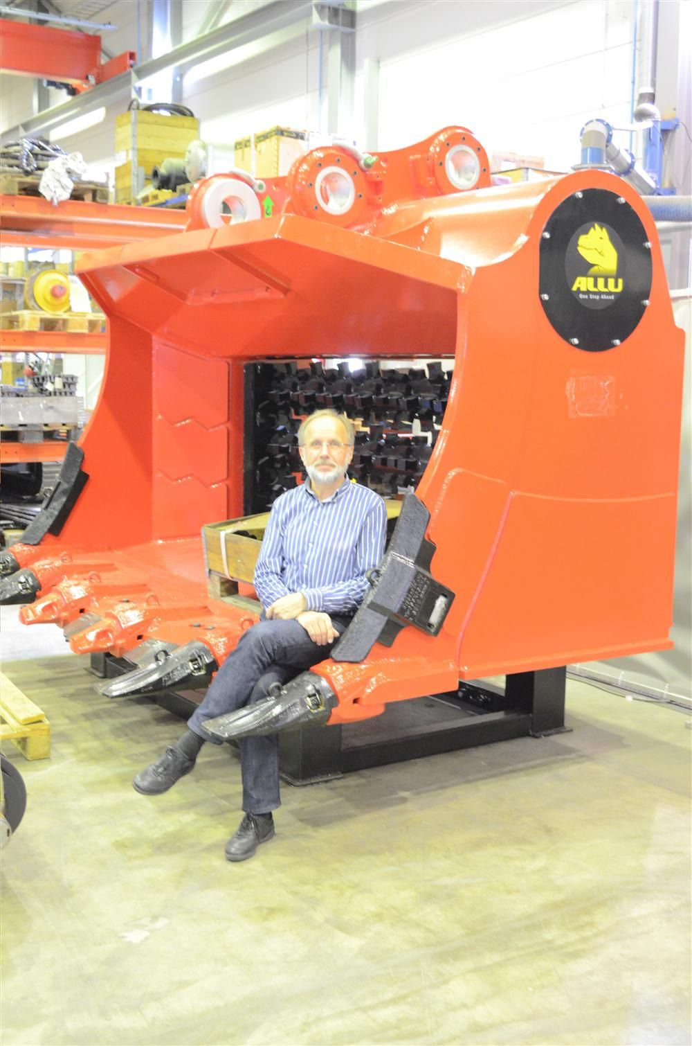 ALLU's Managing Director Kauko Pylvas sits for a photo in the ALLU M series processing bucket.