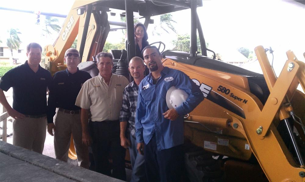 Case Community Challenge grand prize winner, Hubbard Construction, received one year's free use of a Case 580N loader/backhoe. (L-R) are Jim Bansen, Case territory sales manager; David Moore and Bob Ramos, Trekker Tractor; James Ankrum Jr., Freddy C