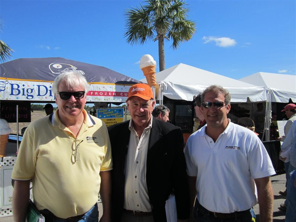 (L-R): Art Bayley, 1st Source Bank; Dave Ritchie, founder of Ritchie Bros. Auctioneers; and Robby Udelson PowerTrac Machinery meet up for a quick photo in Construction Equipment Guide.