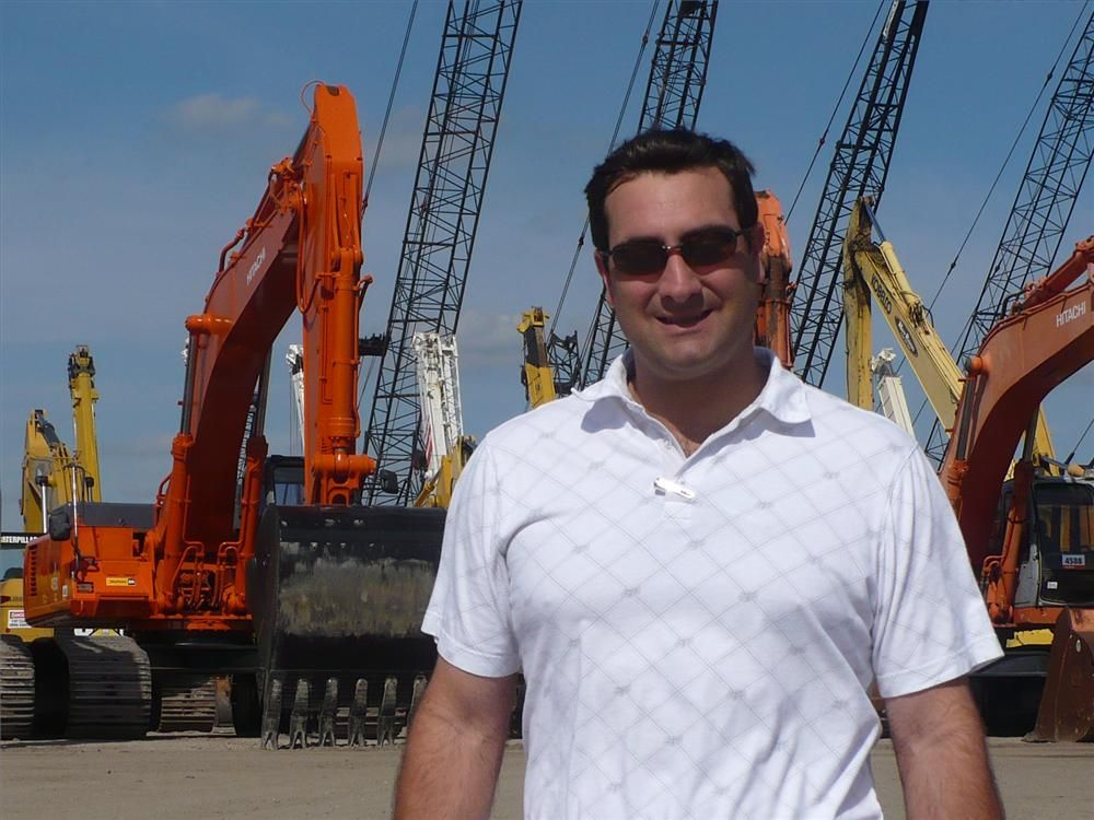 Ronald Miller, president of Trekker Tractor, the Case dealer in Florida, was out looking over some of the excavators for sale.