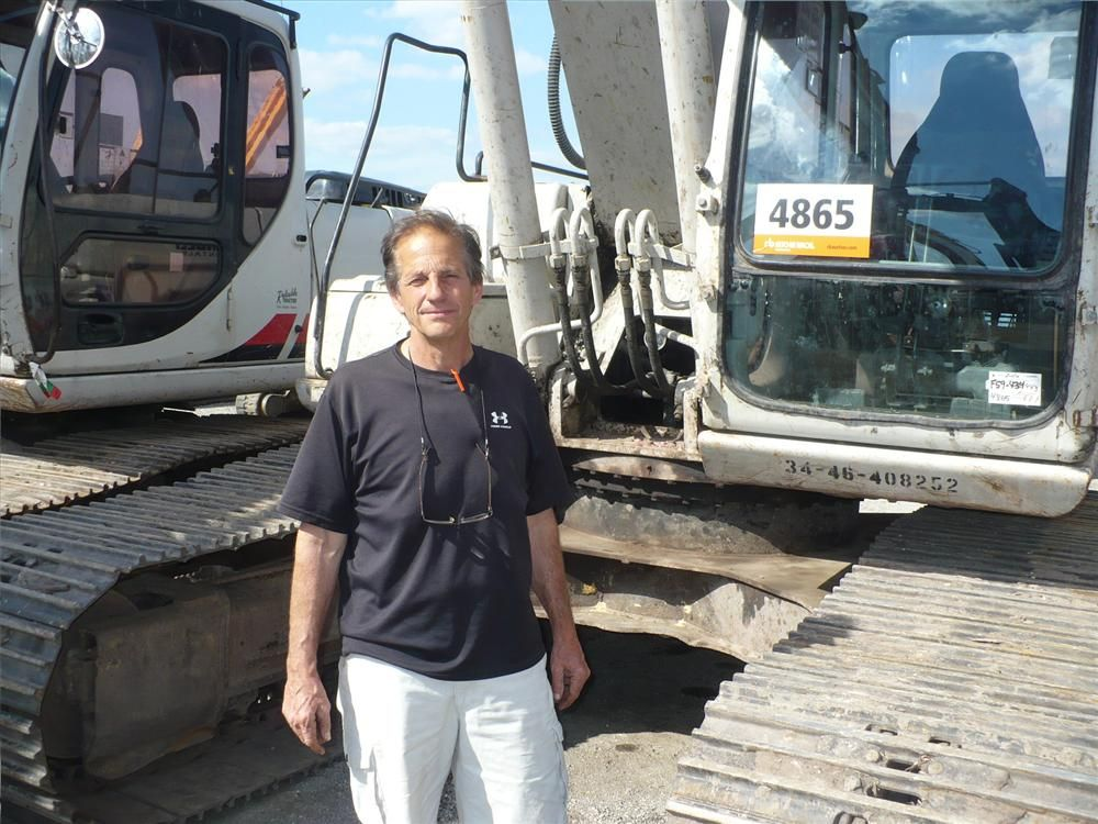 Jim Spano, president of Spano Paving and Excavation, Syracuse, N.Y., shops a couple of excavators. If the price is right, this LBX 210 may be going home with him.