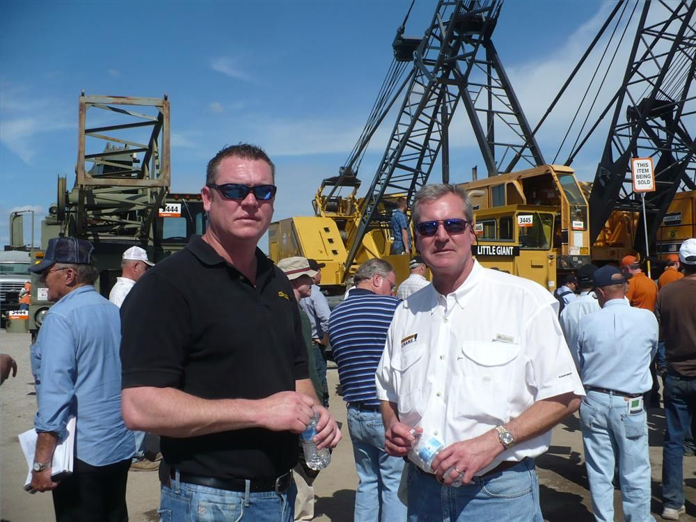 Keith Summerlin (L), Ring Power Crane used sales manager, and Dave Glass, vice president Ring Power Crane, enjoy the great weather while watching the cranes being sold.