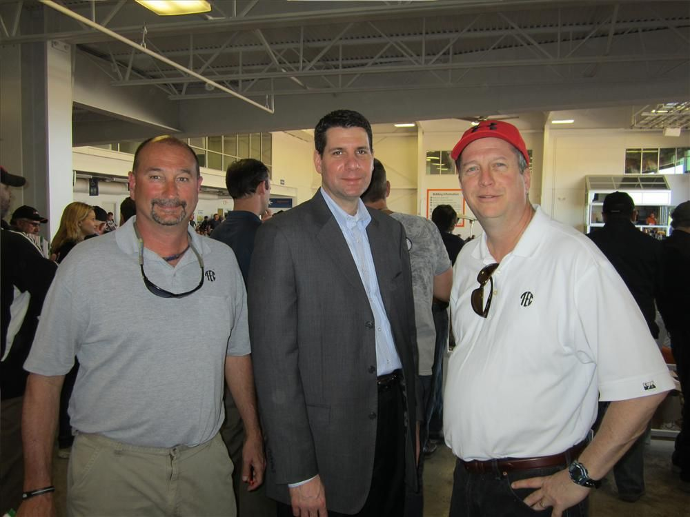 (L-R): Tim Thomas, used equipment manager of Tractor & Equipment Co.; Timothy Tripas, vice president of operations of Komatsu Financial; and Steve McCondichie, vice president and general manager of Georgia Tractor & Equipment Co., discuss what they think