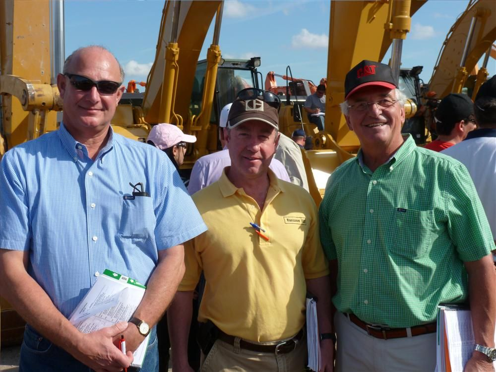Another sunny day in Florida is bound to put a smile on your face. (L-R): Grason Jones and Joe Villa, both of Ransome CAT, Bensalem, Pa.; and Marcel LeHouillier of Marcel Equipment Limited, Ontario, Canada, prove that.