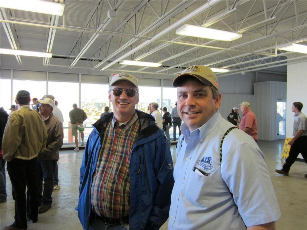 Larry Hilton (L) and Mark Kelso, both of AIS Construction Equipment Corp., keep tabs on the Komatsu wheel loaders.