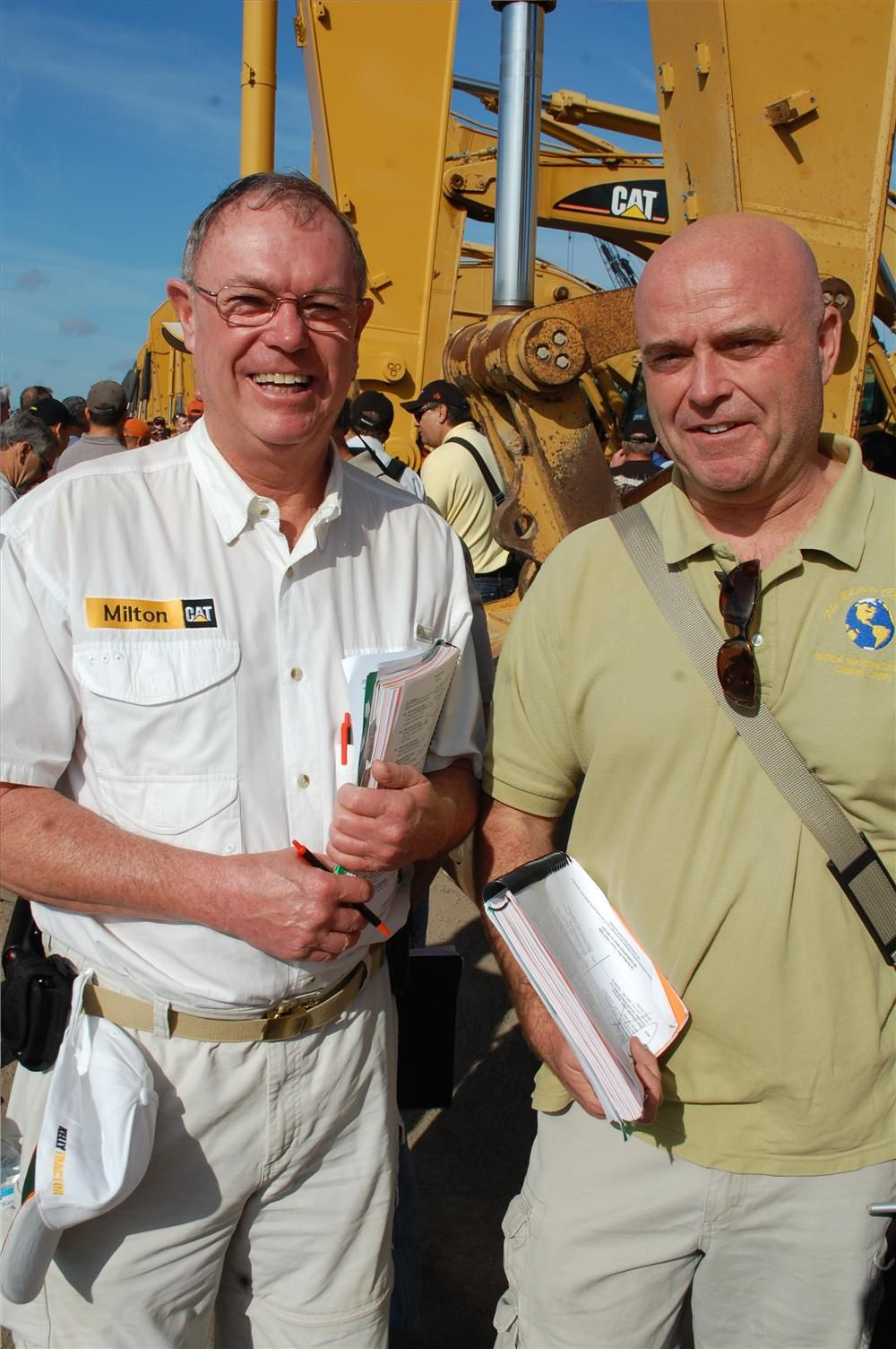 Paul Magoon (L) of Milton CAT and Bryn Smith of The N.I.C.E. Company traveled all the way from eastern Massachusetts to observe excavator prices.