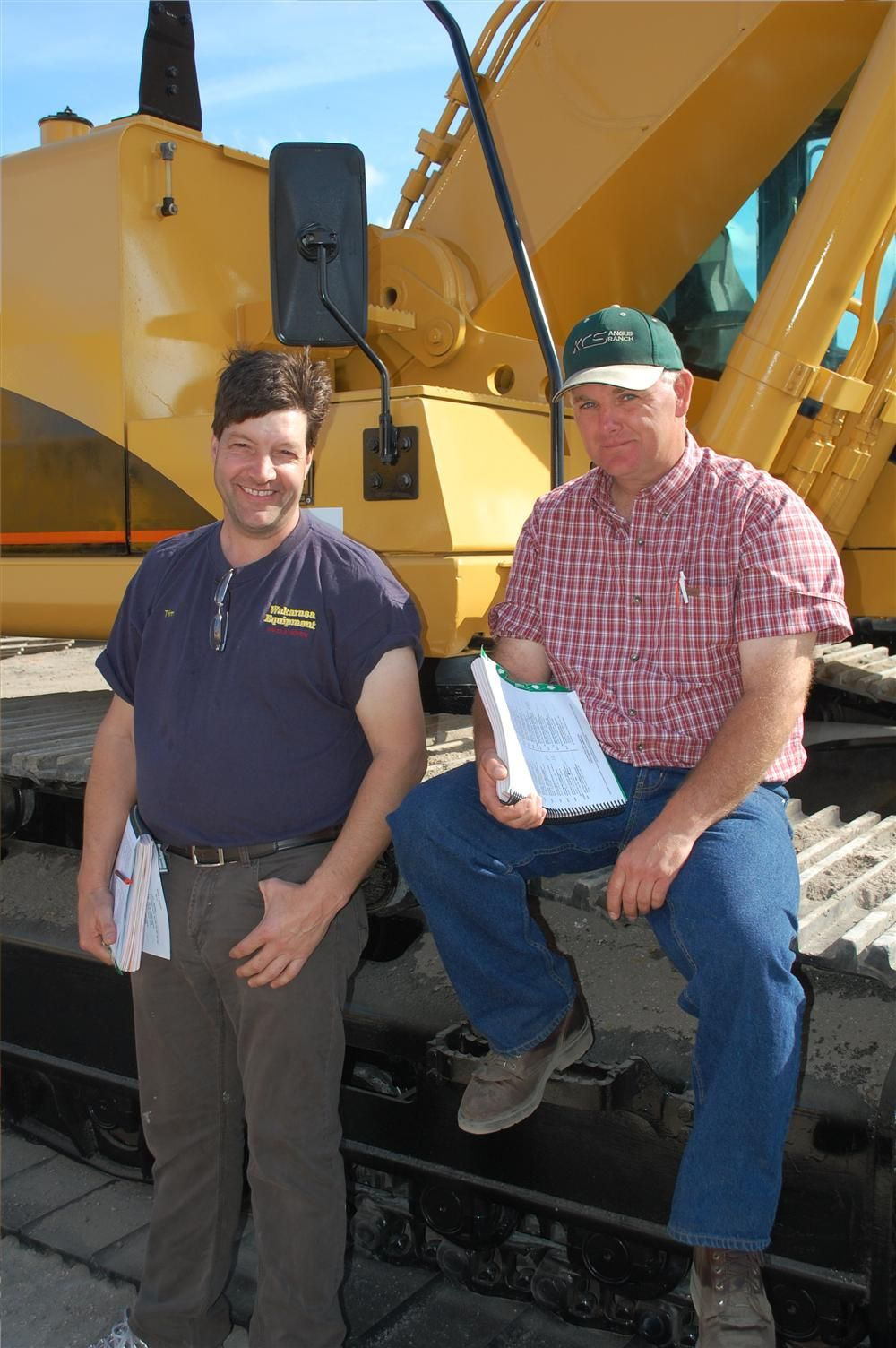 With a Caterpillar 345CL are Timothy Martin (L) of Wakarusa Heavy Equipment in North Central Indiana and Chris Taylor of Chris Taylor Equipment LLC in Kirksville, Mo.