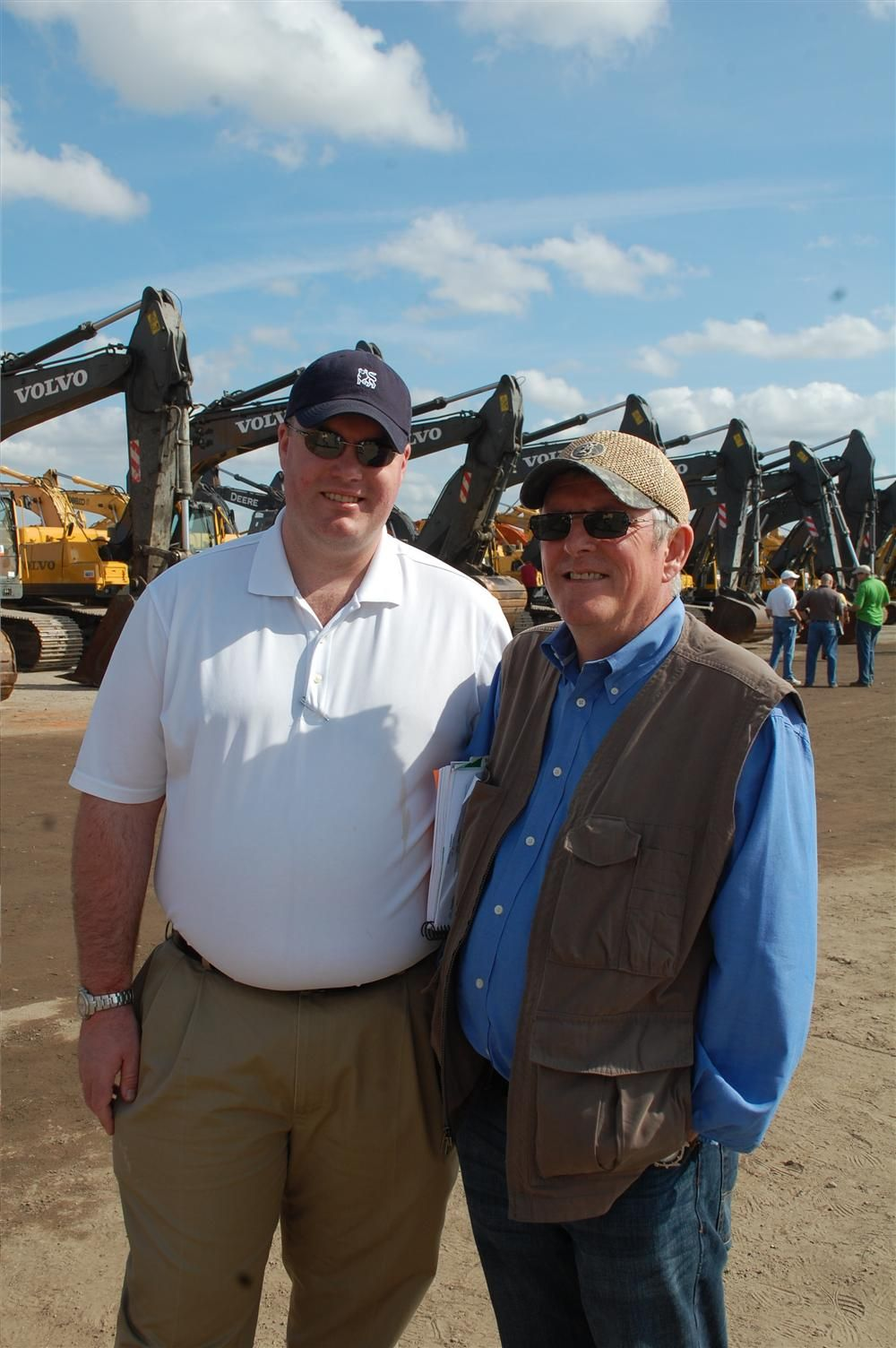 Bruce Knapp (R), used equipment manager of McClung-Logan, is accompanied by his son, Jeffrey Knapp, during day four of the six-day Ritchie Bros. auction.