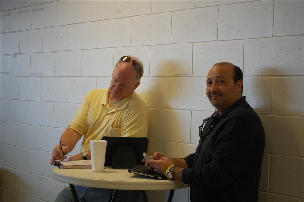 The entire sale site offers Internet access for attendees, such as these two prospective bidders, who prefer to monitor the sale from their ipads.
