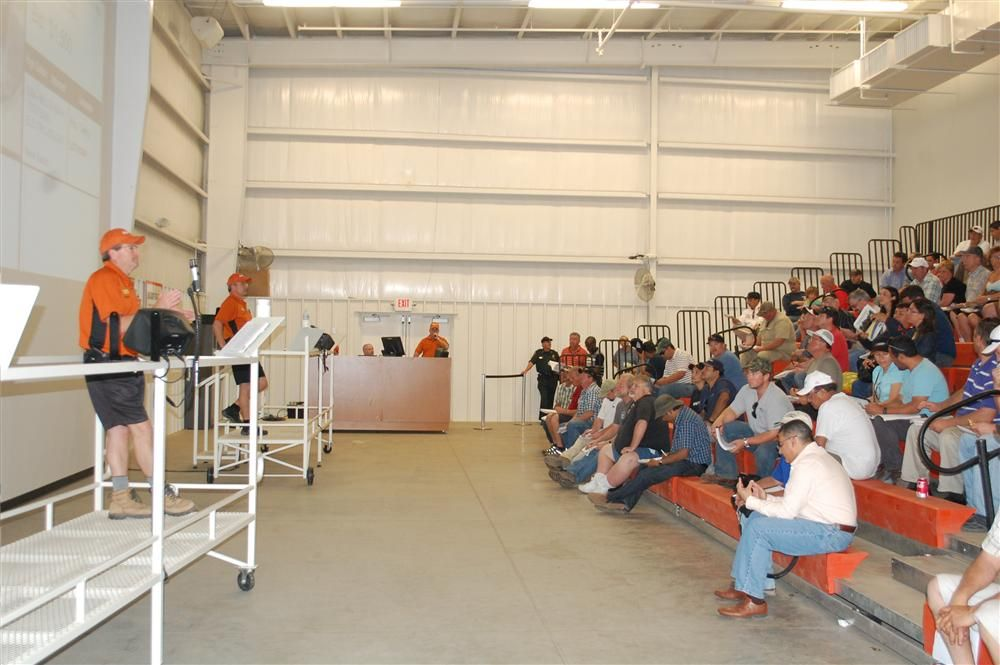 To accommodate smaller items and equipment not located onsite, Ritchie Bros. has established a virtual auction area where photos of items are shown on a large screen.