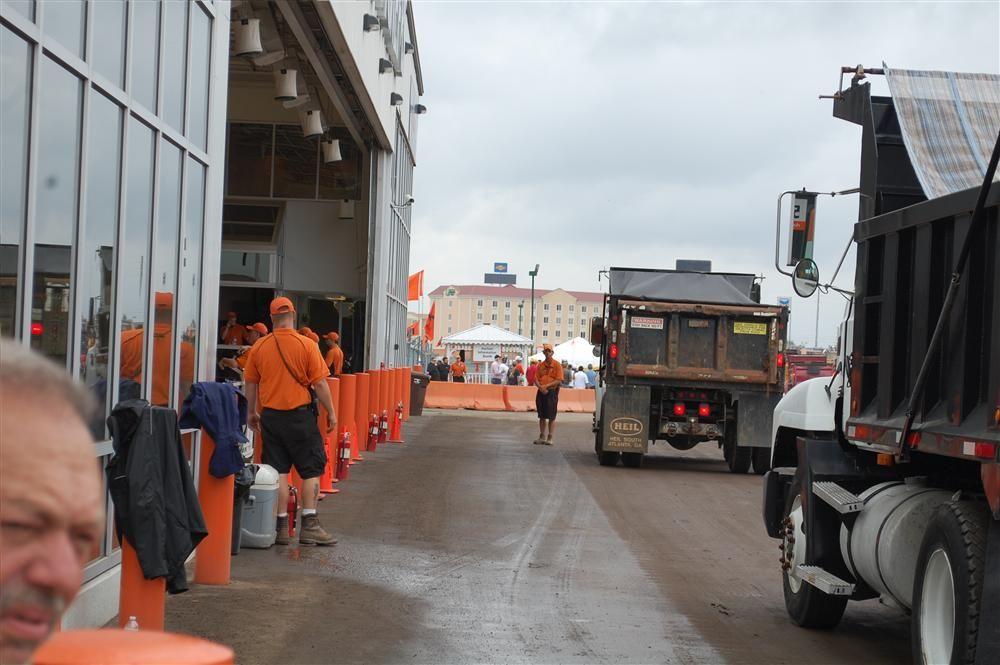 Over the road dump trucks are taken across the ramp for bidding.