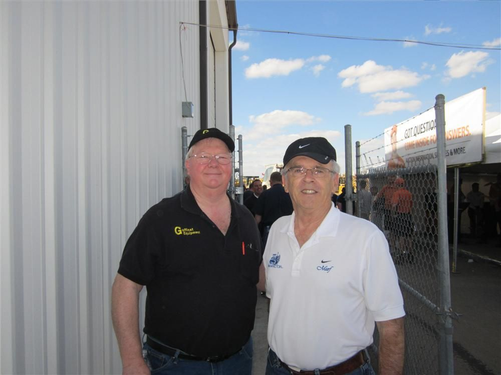 Mike Goffinet (L), Goffinet Equipment Co., and Murf Murphy of Best Tractor Inc. pose for a photo prior to the sale.