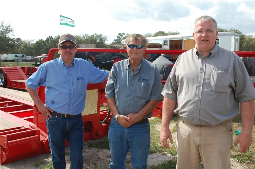 Lucky's Trailer Sale has been an exhibitor at the Yoder & Frey Florida sale for more than 20 years. (L-R): Russell Losh of Talbert Mfg., and Russell Demick and Tim Mills, both of Lucky's Trailers.