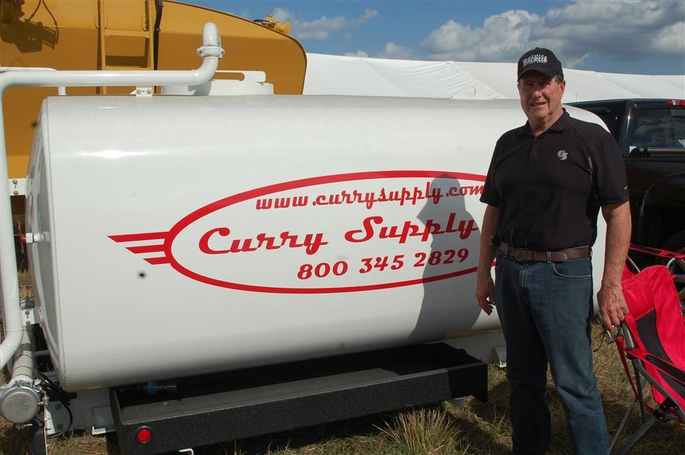 Cary Ritchie of Curry Supply displayed company's water tanks at the Yoder & Frey sale.