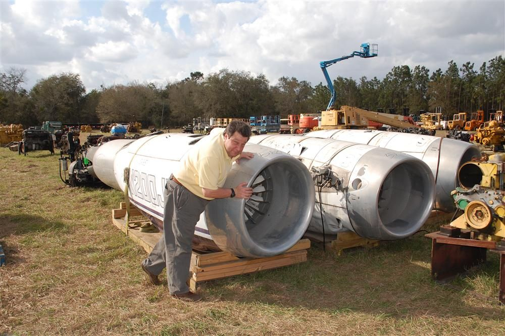 When you get this big of a crowd together, there is a buy for almost anything including  these jet engines being inspected by Kent Hogeboom of Construction Equipment Guide.