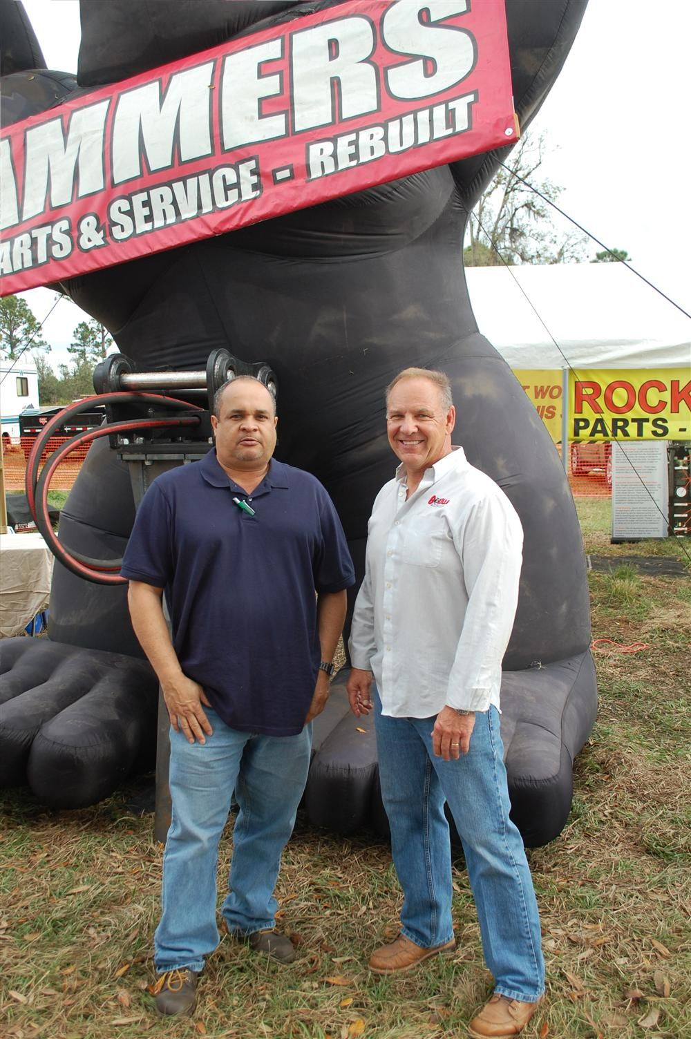 When attending a major show or the Florida auctions look for the big Gorilla to find high-quality hydraulic hammers. Carlos Santos (L) and Bob Tedesco, president of Gorilla Hammers.