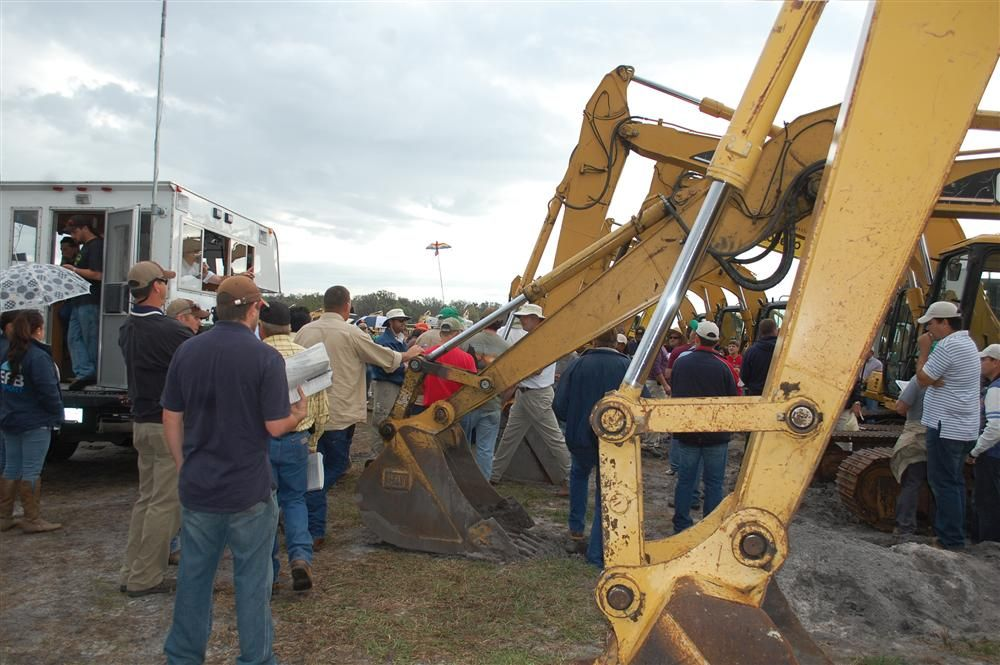 A crowd starts to gather as the gavel begins to fall for the excavators.
