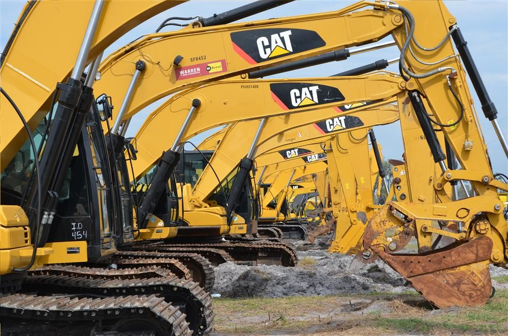 Caterpillar excavators are lined up and ready for owners at the Yoder & Frey auction.