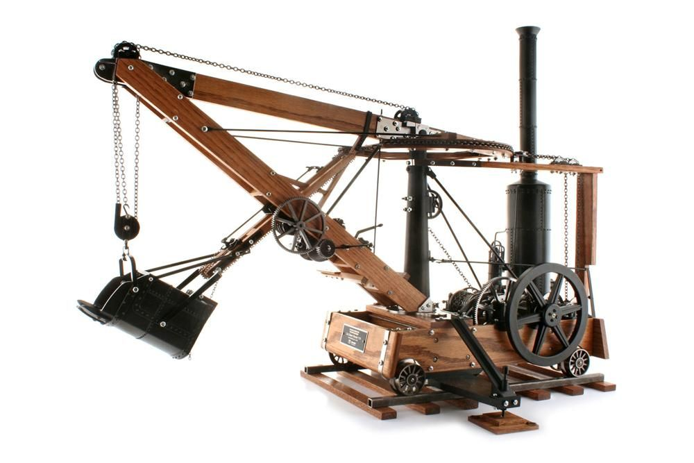 The 1:10 scale model features a swinging boom, extending and retracting dipper stick, rolling wheels, and operational levers, gears, drums and bucket trip, and comes on a section of railroad track for exhibit.