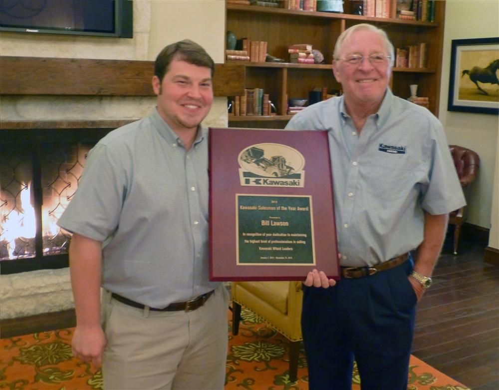 Adam Craft (L), KCMA regional sales manager-Texas, presents the award to Bill Lawson, Bane Machinery.