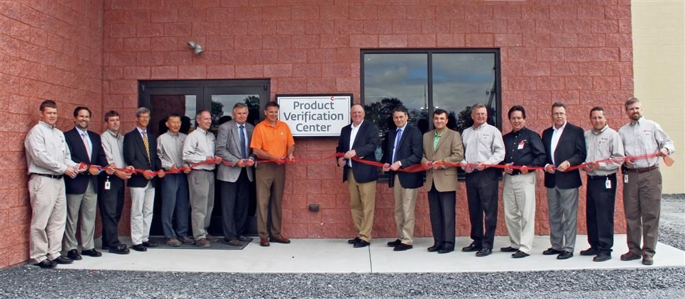 Management from Mainitowoc Cranes cut the ribbon to officially open the company's Product Verification Center at its facility in Shady Grove, Pa.