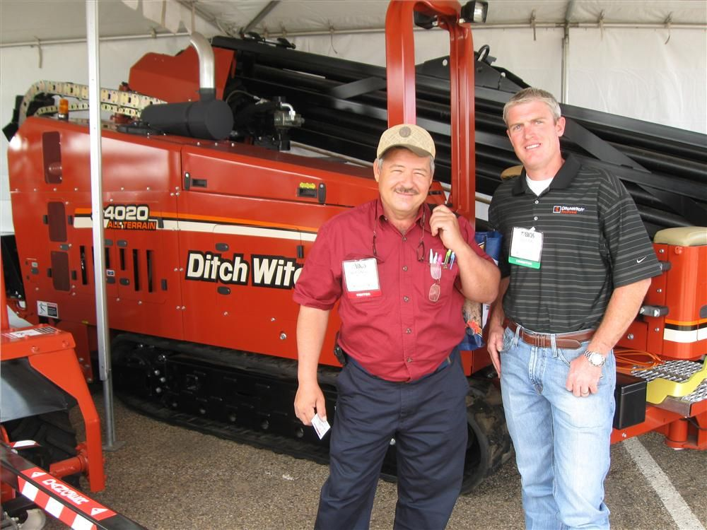Alfonso Garza (L), B.G. Trucking in Odessa, Texas, has been speaking with Dustin Thane, Ditch Witch Southwest about the transportation requirements of the Ditch Witch JT 4020 all-terrain trencher.