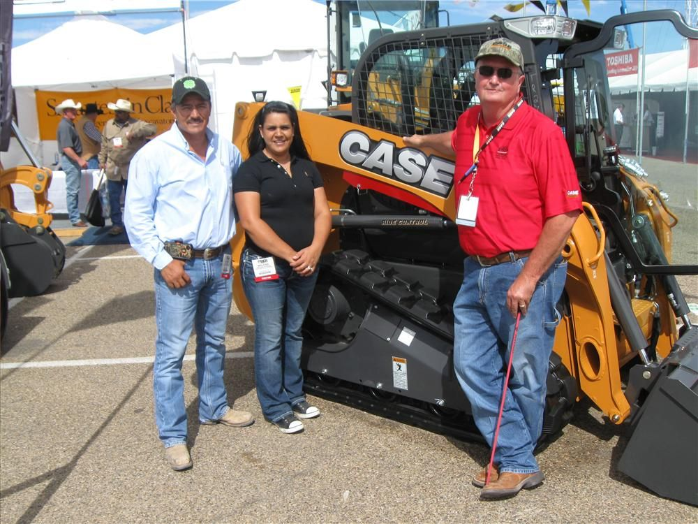 (L-R): Javier and Malena Porras, R&J's Backhoe Service in Monahans, Texas, have been examining the Case TR 270 skid steer loader with Greg Miller of Permian Tractor Sales, Inc., (PTS) in Odessa, Texas.